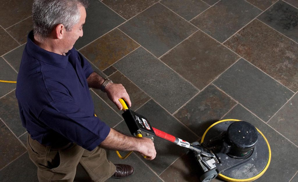 Janitorial Man Waxing Tile Floor
