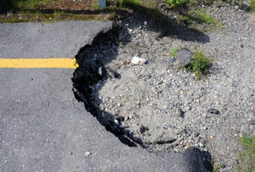 Large pothole in a parking lot